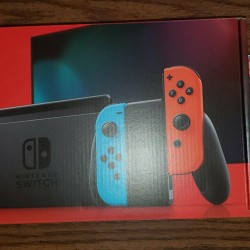 Nintendo Switch with Blue and Red Joy-Con Controllers and Mario Kart 8 Bundle!!!