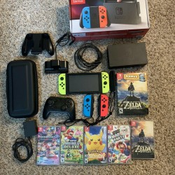 Nintendo Switch Console with 5 games, Multiple Controllers and Carrying case
