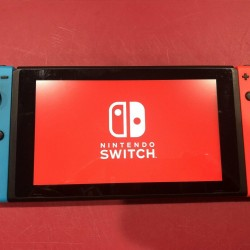 Nintendo Switch V2 32GB Neon Red/Neon Blue Console Used.