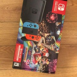 Multiple Nintendo Switch, Blue/Red Joy-Con Controllers and Mario Kart 8 Bundle
