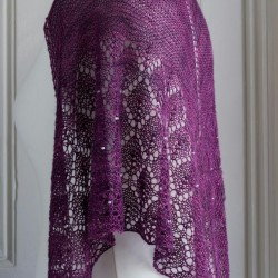 Lace shawl, h  knit in mulberry silk in a triangular shape